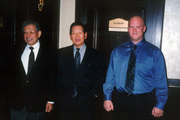 Scott Middleton with Sensei Teruyuki Okazaki (L) and Sensei Yutaka Yaguchi (Middle), at the 2002 Canadian National Championships. Scott Middleton placed 4th in Kumite.